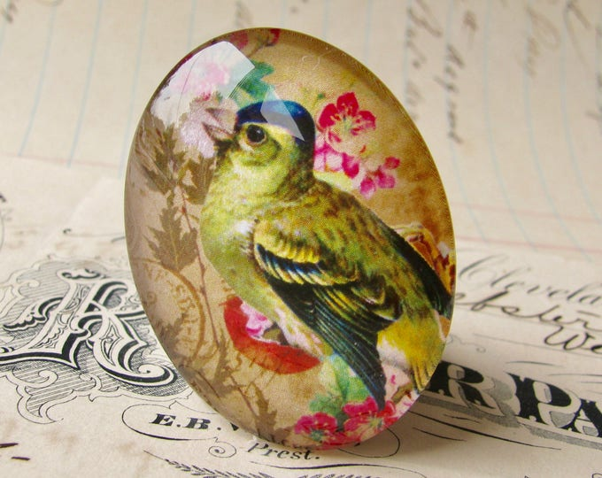 Songbird with flower background, from our Beautiful Birds collection of handmade glass cabochons, 40x30mm, green blue, pink