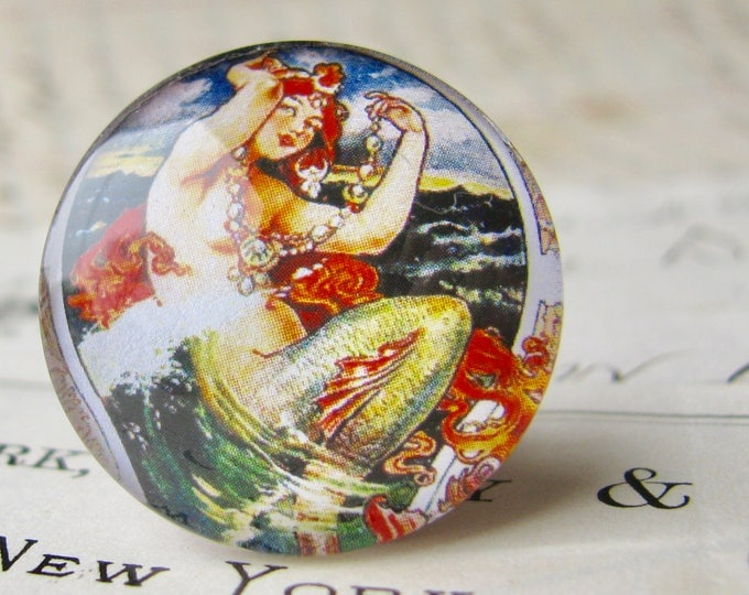 From our Magical Maidens collection, vintage mermaid comic illustration, red hair, 25mm round glass cabochon, 1 inch circle, bottle cap size