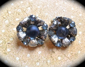 Blue frosted cabochon flower clip on earrings