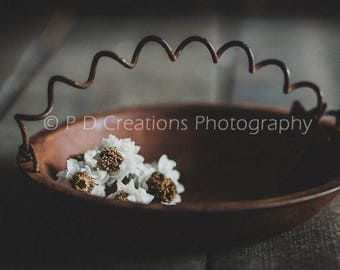 Little White Flowers in Rusty Container