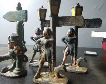 Vintage metal/ lead man and woman by sign toy