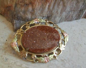 Vintage goldstone gold fill brooch, oval, gold overlay, gold fill appliques, filigree, delicate, natural gemstone, organic, collectible