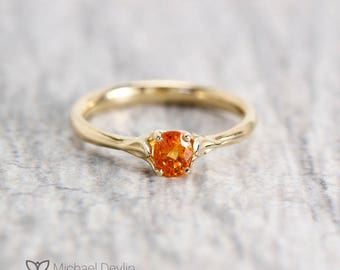orange sapphire soliatre ring