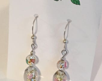 Sterling Silver .925 earrings with clear crystal beads that have tiny pink flowers inside and are on hanging fishhook findings