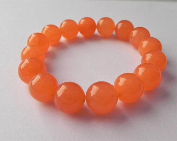 Orange colour dyed quartz gemstone stretch bracelet.