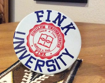 Fink University tin litho pin back button large 1960s collectible pin