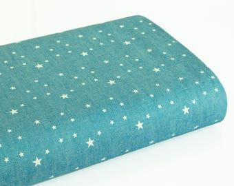 Cotonnade motif étoile sur fond bleu denim delavé  - 50 cm