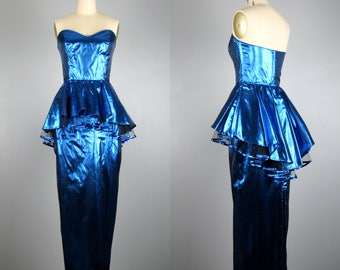 Vintage 1980s Dress 80's Blue Metallic Tissue Lame Column Gown with Waterfall Peplum by L.A. Glo Size XS