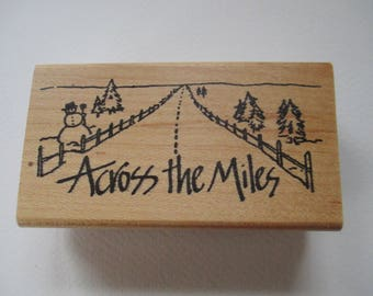 """Wood mounted rubber stamps """" Across the Miles"""" stamp used."""