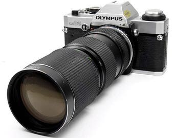 Olympus OM20 Classic Vintage 1980s SLR 35mm Film Camera with 85-210mm Zoom Lens
