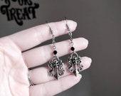 Gothic antique silver filigree skull dangle earrings.