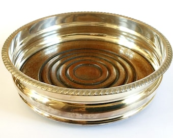 Silver plated wine bottle coaster, Turned wooden base, Ribbed edge,