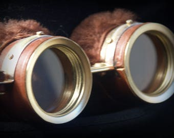 Steampunk goggles in brown leather and brass with fur trim.