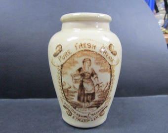 antique cream stoneware container