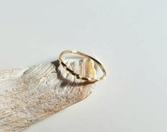 Dainty 14k gold infinite twist ring with tiny sphere, size 8