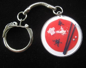 """Keychain """"Sushi - flag of the Japan"""" set in resin"""