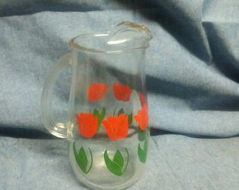 Vintage juice pitcher with tulips