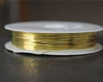 a spool of 0.4 mm gold copper wire 13 M