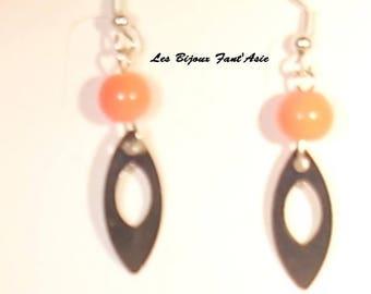 Orange glass bead hook earrings and silver metal openwork leaf