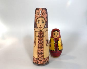 Wonderful unique wooden candle holder embossed with the image of a woman
