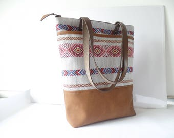 Leather and cotton zippered tote bag with two exterior pockets