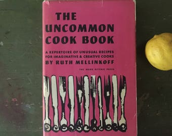 The Uncommon Cook Book, MCM, Pink Covers and Endpapers, Bold Cutlery Design, unusual Recipes, Creative Cooks, great Gift, pink book stack