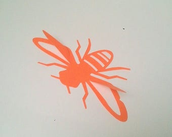 """The 2 """"Bee"""" stickers with adhesive on the back of the color orange"""