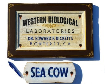Doc's Laboratory John Steinbeck Cannery Row Sign + Sea Cow sign