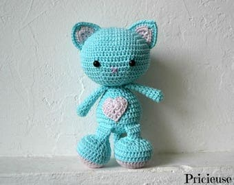 Amigurumi Doudou Cat with turquoise crochet and pale pink