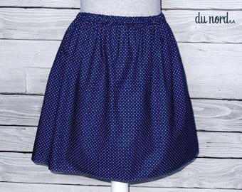 Skirt has polka dots, Navy blue cotton has small white polka dots, Navy blue cotton.