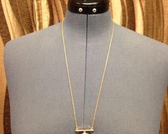 Authentic designer button repurposed into necklace