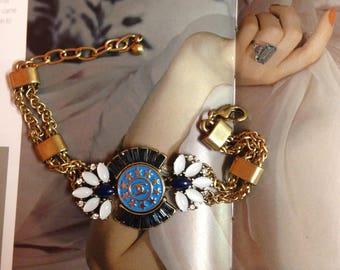 Authentic designer button repurposed into the vintage bracelet