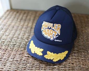 vintage muffler mart spkane navy blue foam dome hat