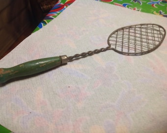 Vintage metal Hand Whisk or strainer  with green wooden handle - USA