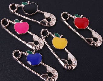 X 1 gold safety pin and its Royal Blue Apple 35mm