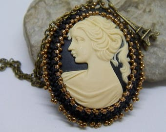 Bronze cameo pendant set with seed beads