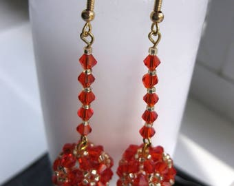Dangling long earrings with balls