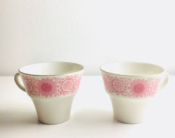 "A pair of vintage Arabia Finland Sun flower pattern coffee cups named ""Heili"", Raija Uosikkinen, 1960"