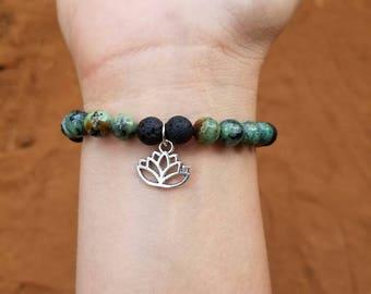 aromatherapy  bracelet- healing bracelet- reiki - lava beads bracelet- genuine gemstone and lava bead bracelet - lotus charm- yoga - ohm