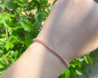 Bracelet with pink gold hematite washers