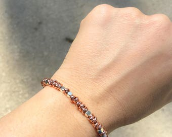 Bracelet with pink gold aluminum nods and silver or silver ankles