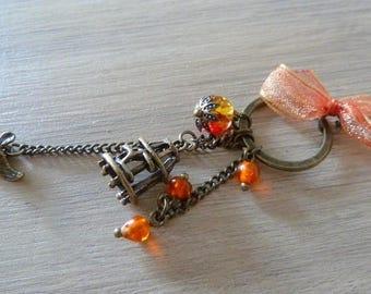 Necklace orange bird and cage