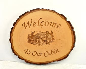 Welcome to our Cabin Bark Edge Oval Sign