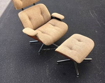 Eames style recliner made by Selig with ottoman.