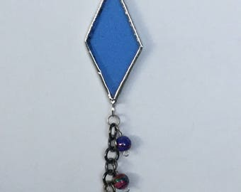 Hand crafted stained glass pendant, created using Tiffany style technique, on a .925 silver plated chain