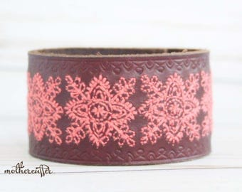 CUSTOM HANDSTAMPED brown leather cuff with pink stitching by mothercuffer