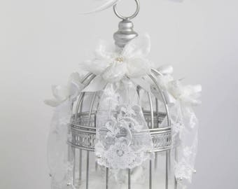 Ring bearer bird cage with Angel on a bed of feathers and lace flowers