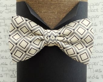 Bow ties for men, geometric grey print on a cream background pre tied or self tie bow tie