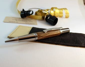 Pen has facets in walnut and its leather case
