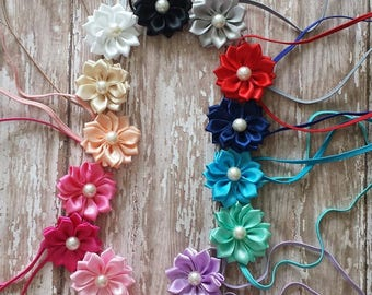 You choose from 15 colors skinny elastic newborn, infant flower headbands